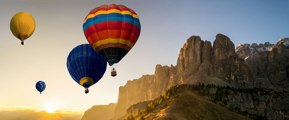 Printed roller blinds Balloon Beautiful panoramic nature landscape of countryside mountains with colorful high hot air balloons festival in summer sky. Vacation travel panorama background.