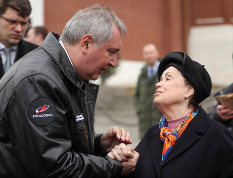 Rogozin, head of the Russian space agency Roscosmos, speaks with Korolyova, daughter of Sergei Korolyov, prominent Soviet rocket and spacecraft engineer, during a ceremony to mark Cosmonautics Day in Moscow