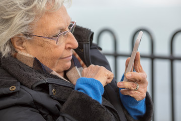 Happy Old Woman Using Mobile Phone