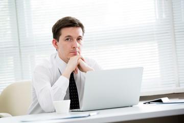 Portrait of businessman in an office