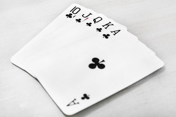 Picture of black royal playing cards. Isolated on the grey background.