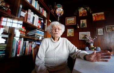 Lisel Heise, a 100-year-old former teacher, answers a reporter's questions  inside the living room of her house Kirchheimbolanden