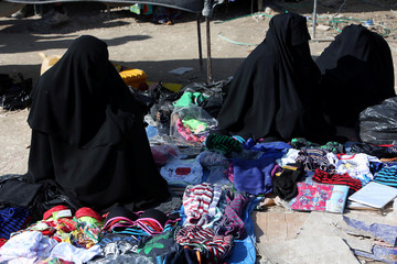 Women sell underwear at al-Hol displacement camp in Hasaka governorate