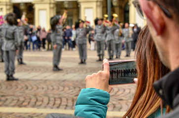 People photograph and film an exhibition of the military