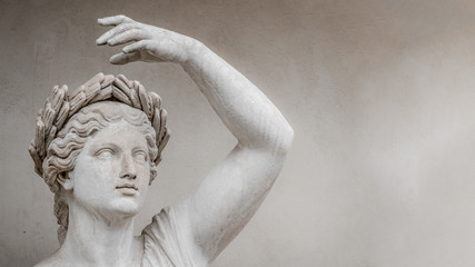 Statue of sensual Roman renaissance era woman in circlet of bay leaves, Potsdam, Germany, details, closeup