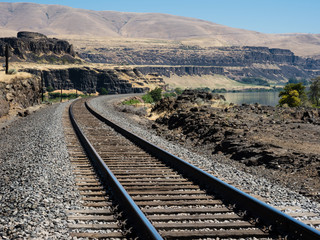 Railroad tracks running along Columbia River in eastern Washington state, USA