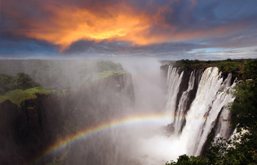 Victoria Falls sunset with rainbow, Zambia Wall mural