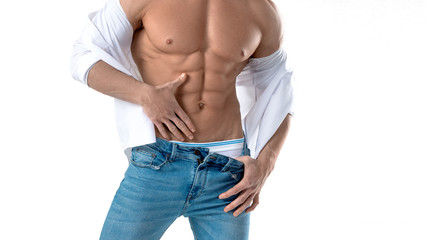 Muscular male torso in white shirt and blue jeans isolated on white Wall mural