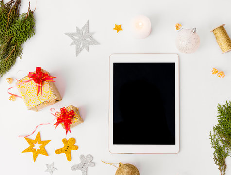 tablet isolated for christmas time stylish mock up, cones and fir brances on white background,