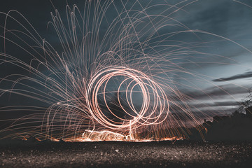 Long exposure of illuminated abstract circles above ground in evening in Lanzarote, Canary Islands, Spain