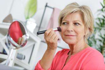 senior woman doing make-up