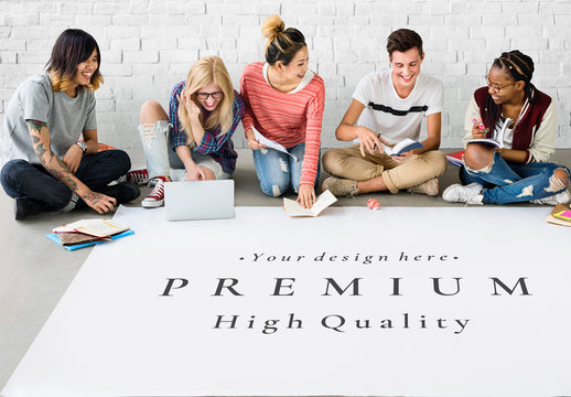 5 People in Front of a Lage Piece of Paper Mockup