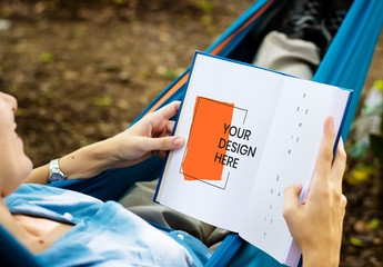 Person Reading a Book Outdoors Mockup