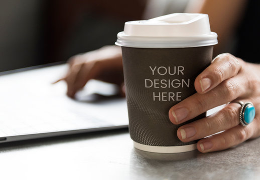 Hand Holding Cup of Coffee Mockup