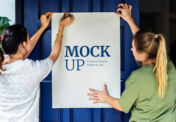 2 People Putting Up a Poster Mockup