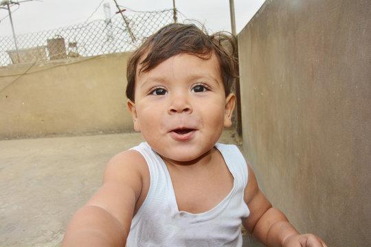 Happy latin toddler outside.