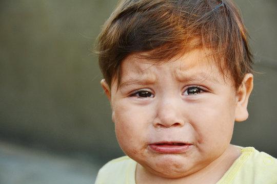 Latin toddler boy crying.