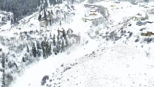 Wall mural Aerial view of rural mountain community in the Winter.