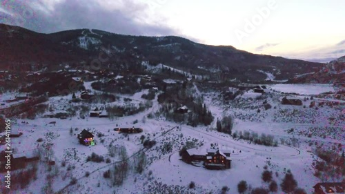 Wall mural Aerial view of rural mountain community at sunset  in the Winter.
