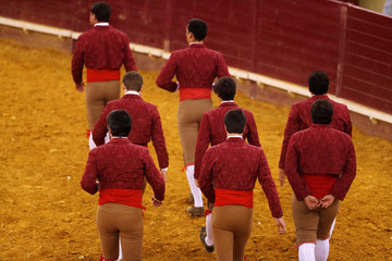 Members of Montemor forcados group perform during a bullfight at Campo Pequeno bullring in Lisbon