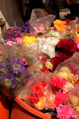 Picture of a booth with fresh and artificial flowers taken in Beer-Sheva (Israel) farmers market.