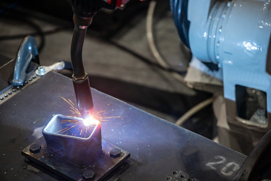 The robotic arm  additive welding the sample  parts. The hi-technology automotive part manufacturing process in industrial 4.0 concept.