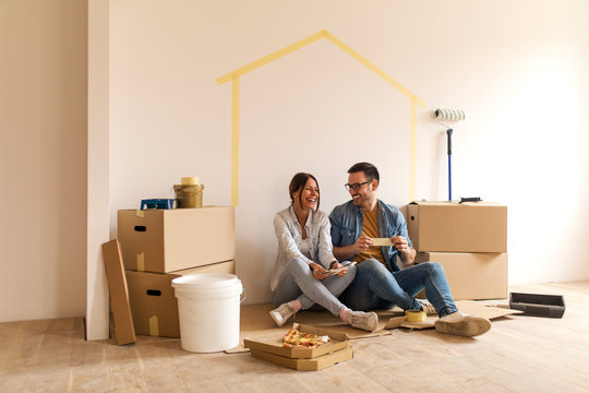 Happy couple in their new apartment.
