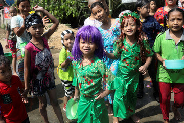 Children pose for a picture to mark Thingyan, Myanmar's New Year Water Festival, in Yangon