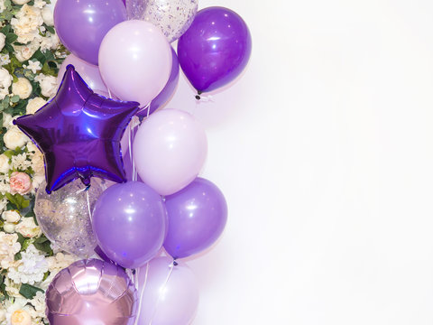Lots of purple, pink and white balloons on white background