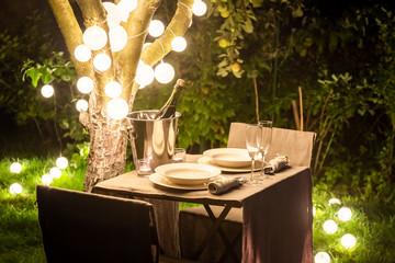 Fototapeta Illuminated table for two in the summer evening obraz