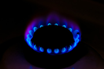Included gas burner burning in the dark unattended. The concept of safe use of gas appliances