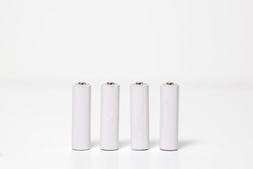 Small batteries. Clean white blank pattern is good for branding design. Background texture.
