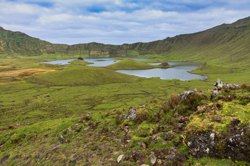 Volcanic crater (Caldeirao) with a beautiful lake on the top of Corvo island. Azores islands, Portugal.