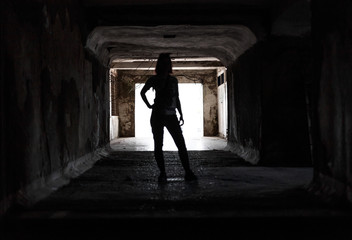 girl silhouette in ruined old tunnel , abkhazia