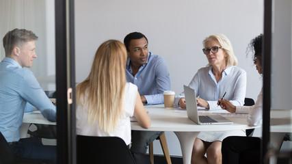 International negotiators or diverse office staff talking negotiating in boardroom