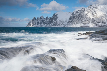 Okneset and Ersfjord from Tungeneset on a stormy day with breaking waves and spray. Sunny day in Mountains And Fjords, Winter Landscape, Norway Beautiful christmas time near Troms county.