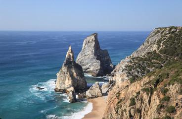 sandy wild beach with amazing rocks. Ursa Beach at atlantic coast, Portugal