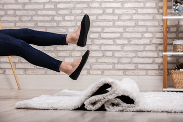 Woman Stumbling With A Carpet