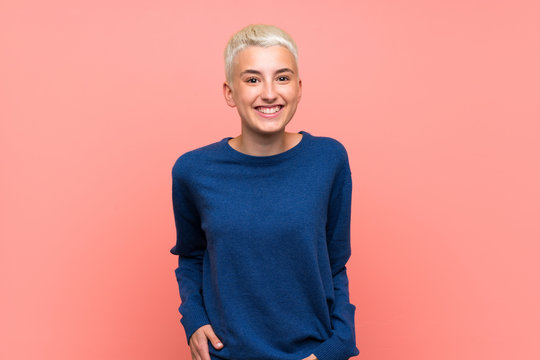 Teenager girl with white short hair over pink wall laughing