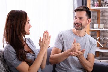 Couple Communicating With Sign Language