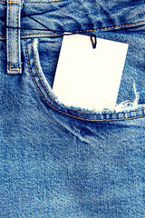Blue denim fabric with a pocket as a background.