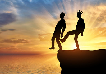 Selfish man with a crown is pushing the foot of his business partner into the abyss