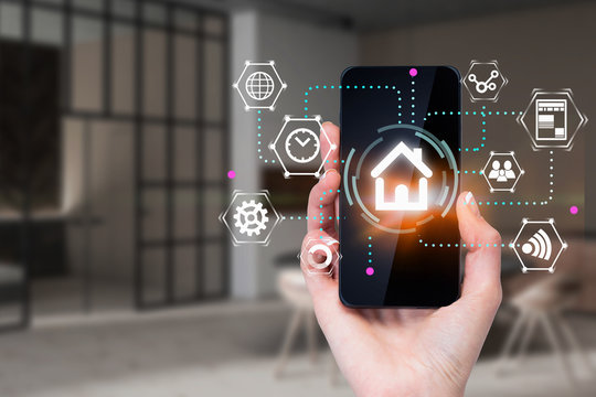 Woman hand with phone, smart home concept