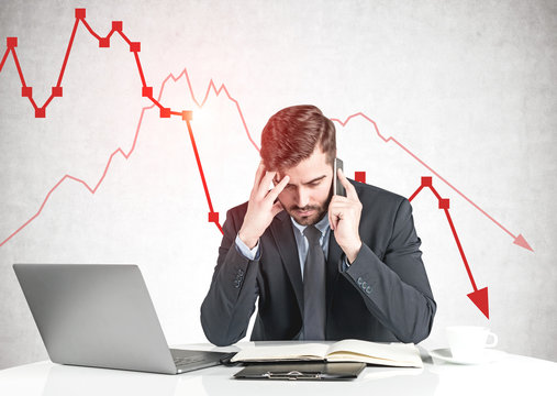 Concerned businessman and falling graph