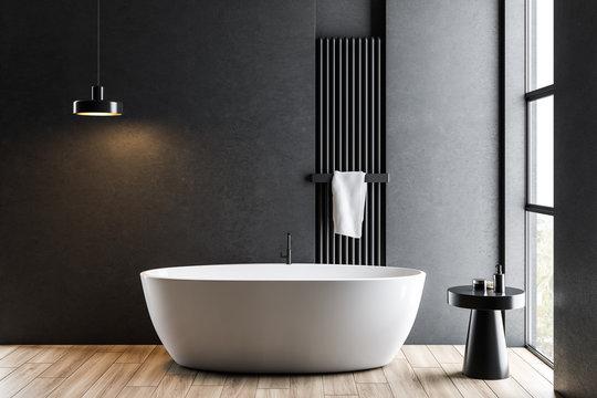 Dark gray bathroom with white tub