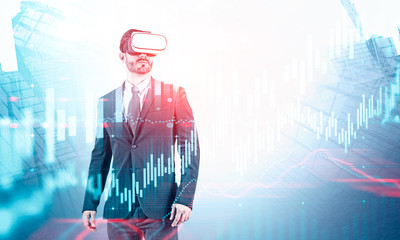 Businessman in VR headset, virtual graph