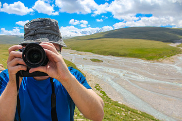 A man takes pictures in the steppes of Kyrgyzstan