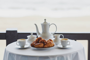 Two cups of coffee and traditional French pastry in cafe or restaraunt