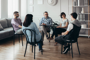 Group therapy session for young men and women