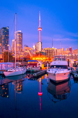 Wall Murals Toronto Blue hour at Toronto harbor with CN tower and high rise buildings as background